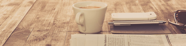 Picture of newspaper and coffee