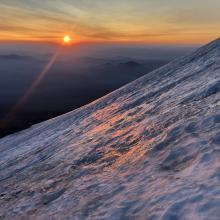 Sun rise over icy spot below the ramp