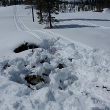 Slash piles are traps for snowmobiles