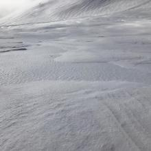 Wind textured and icy snow surface