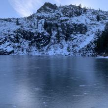 Frozen lake with Middle Peak in the background