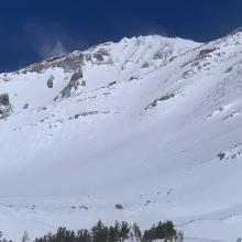 The upper mountain and spindrift blowing around