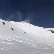 Looking up powder bowl, note: hard wind slabs toward bottom of slope