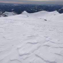 Wind pressed snow, scoured areas, sastrugi, and wind board remain at high altitudes