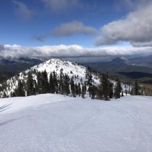 Hard wind pressed snow on ridgeline. A shallow snowpack exists on Right Peak.