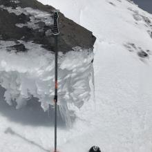 Thick rime/water ice on rocks near ridge lines at upper elevations