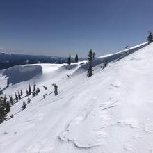 Large overhanging cornices on Middle Peak